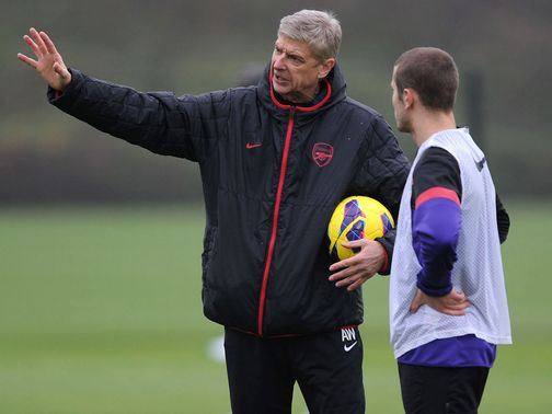 Wenger (left) believes Wilshere (right) can become one of the best players in the world