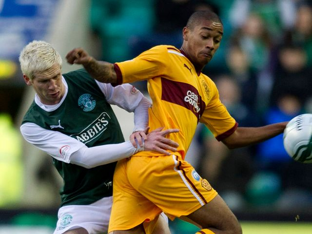 Ryan McGivern and Chris Humphrey battle for the ball