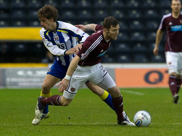 Borja Perez and Darren Barr battle for the ball