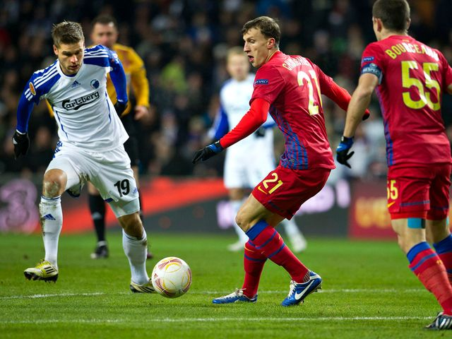 Rurik Gislason and Vlad Chiriches battle for the ball