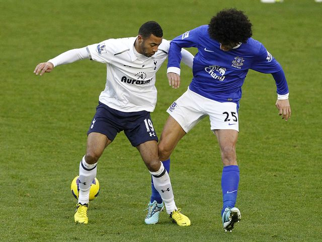 Mousa Dembele and Marouane Fellaini vie for the ball