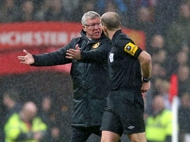 Ferguson has a word with Mike Dean