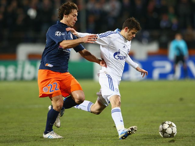 Stambouli and Barnetta battle for the ball