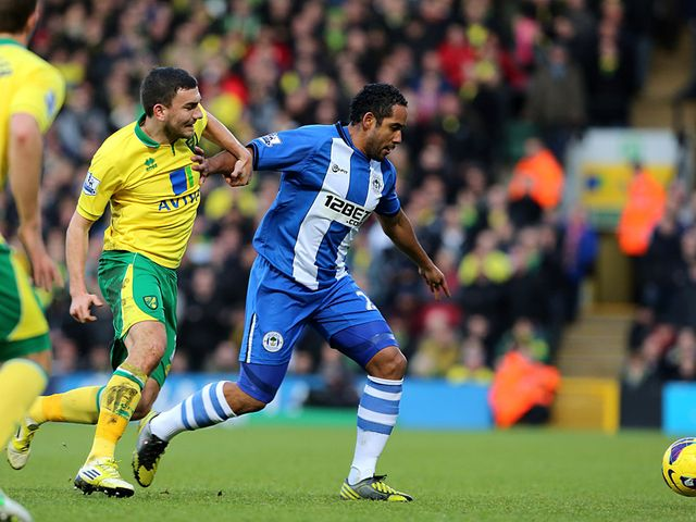 Snodgrass and Beausejour battle for the ball