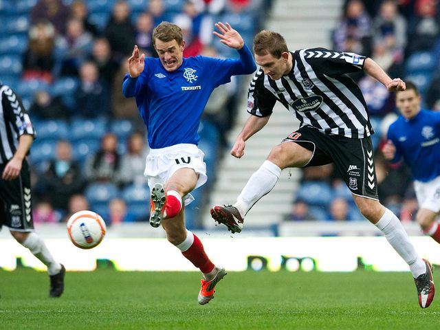 Nicolson knocks the ball away from Shiels.