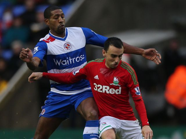 Leon Britton holds off Mikele Leigertwood