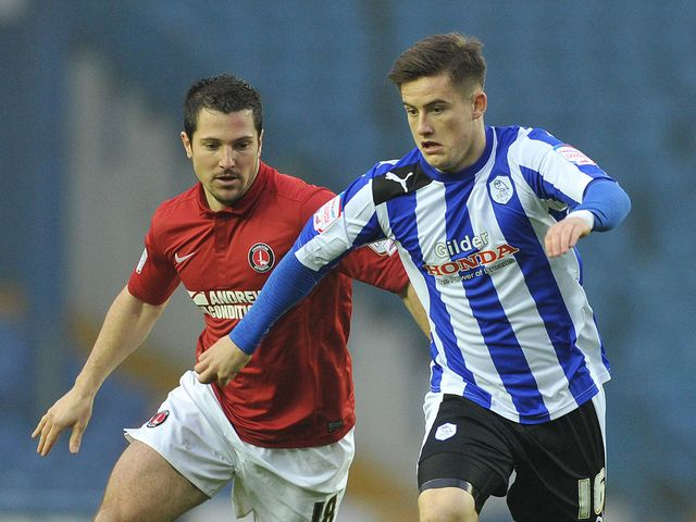 Yann Kermorgant and Rhys McCabe battle for the ball