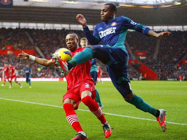 Nathaniel Clyne and Danny Rose battle for the ball