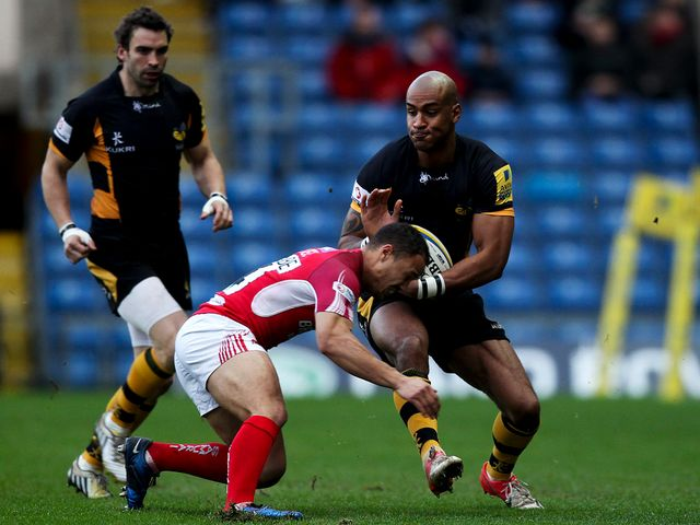 Wasps' Tom Varndell is tackled by Dan Caprice