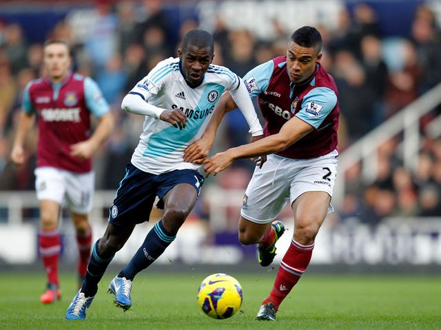 Ramires and Winston Reid battle for the ball