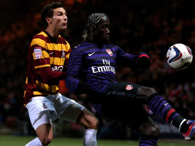 Will Atkinson and Bacary Sagna battle for the ball