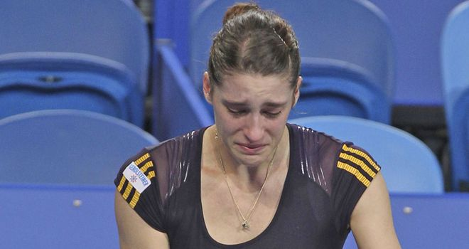 Andrea Petkovic (right) pulls out of her Hopman Cup match