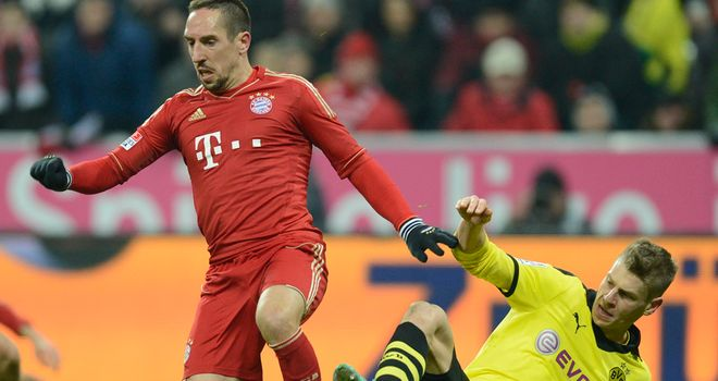 Franck Ribery is challenged by Lukas Piszczek
