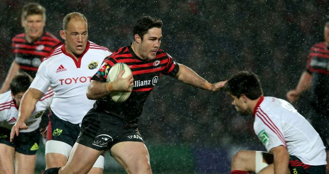 Brad Barritt of Saracens steps inside Conor Murray of Munster