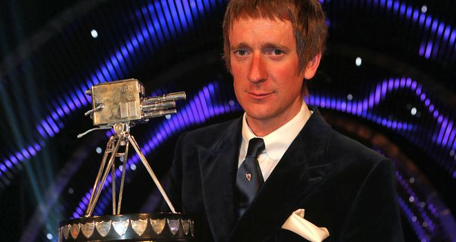 Bradley Wiggins collects the famous trophy