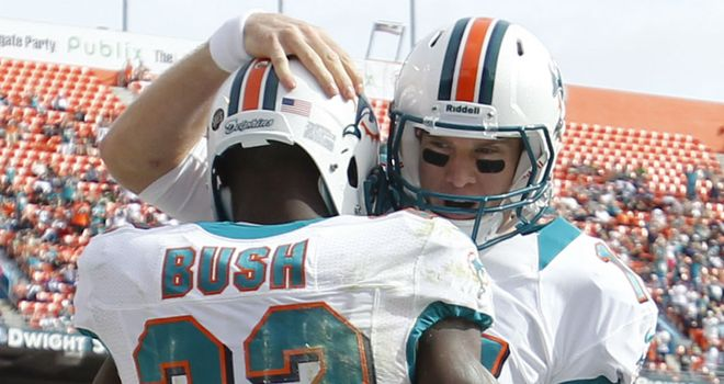 Reggie Bush: congratulated by Ryan Tannehill after one of his three touchdowns