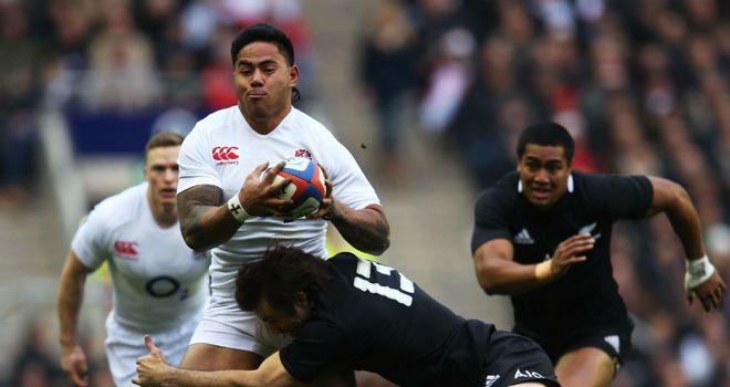 Manu Tuilagi is tackled by Conrad Smith