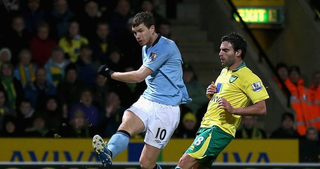 Edin Dzeko: At the double for Man City away at Norwich