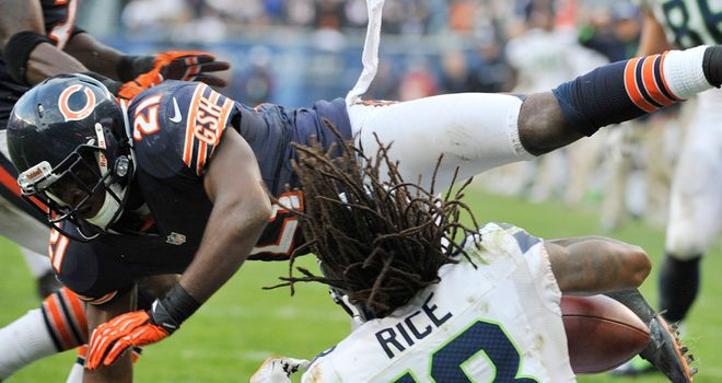 Sidney Rice: Seattle receviver takes a blow as he scores the winning touchdown