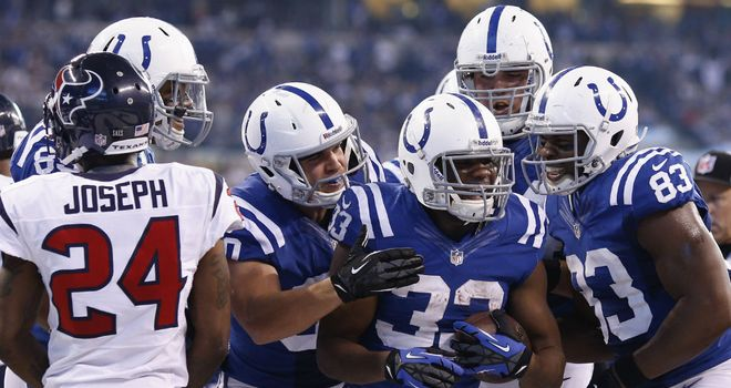 Vick Ballard: congratulated by his fellow Colts after rushing for a touchdown