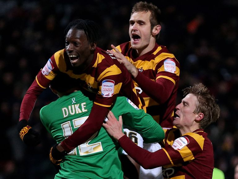 Bradford celebrate their penalty shoot-out victory