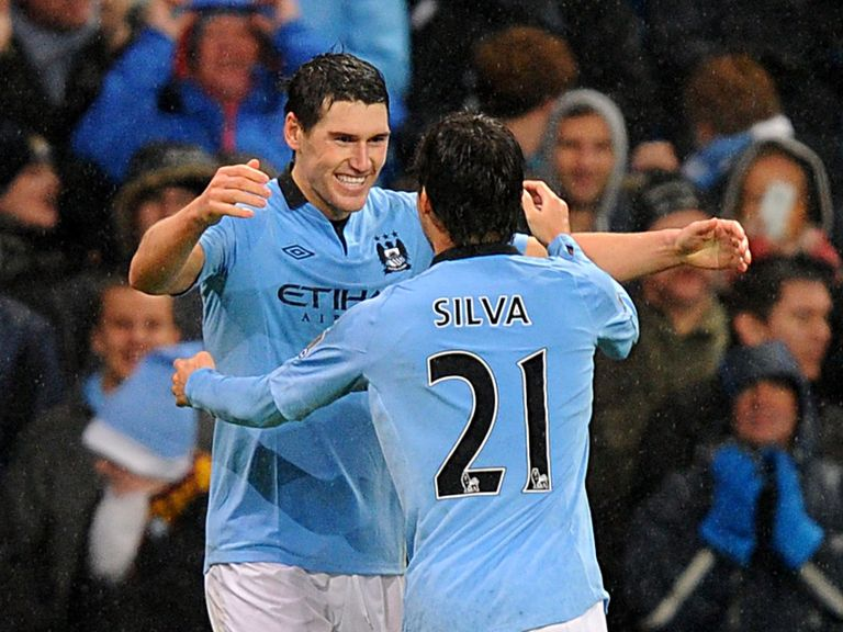Gareth Barry celebrates his late goal