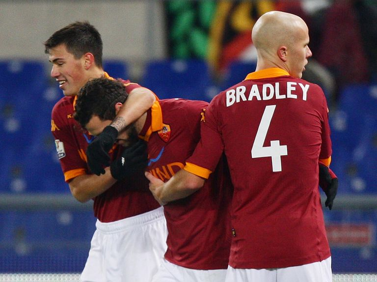 Matteo Destro is mobbed after his goal