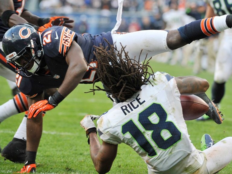 Rice takes a blow as he scores the winning TD