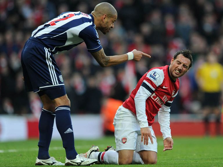 Steven Reid takes issue with Santi Cazorla