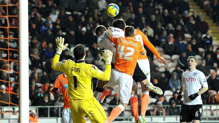 Brede Hangeland heads Fulham into round four