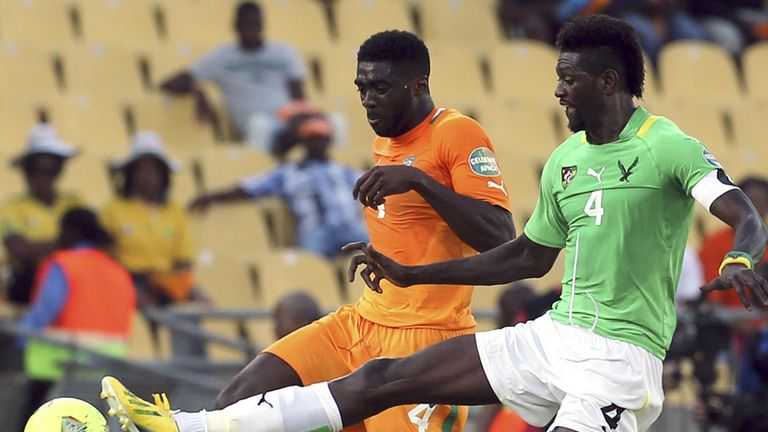 Emmanuel Adebayor and Kolo Toure: Battle for possession in tight contest
