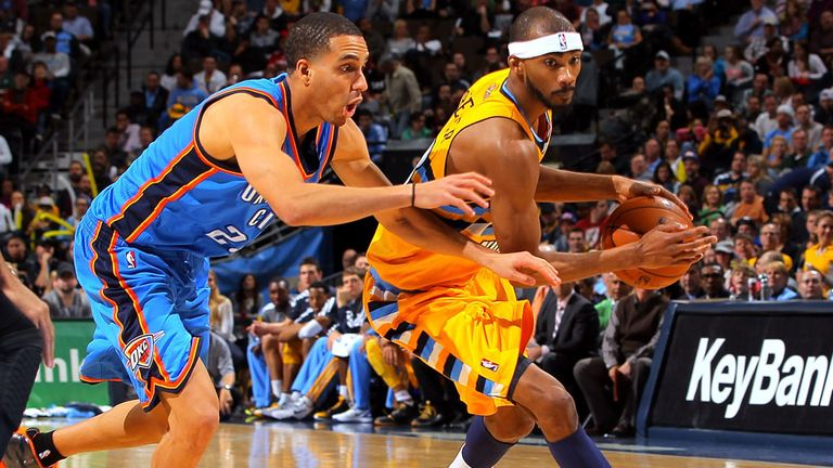 Kevin Martin and Corey Brewer in action
