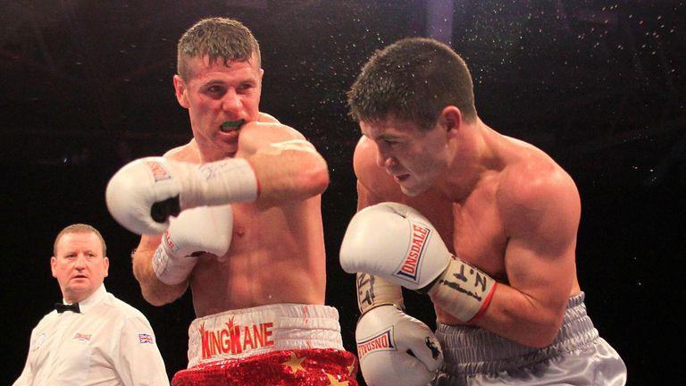 Eamonn O'Kane lets a left hand go against John Ryder (Pic Lawrence Lustig)