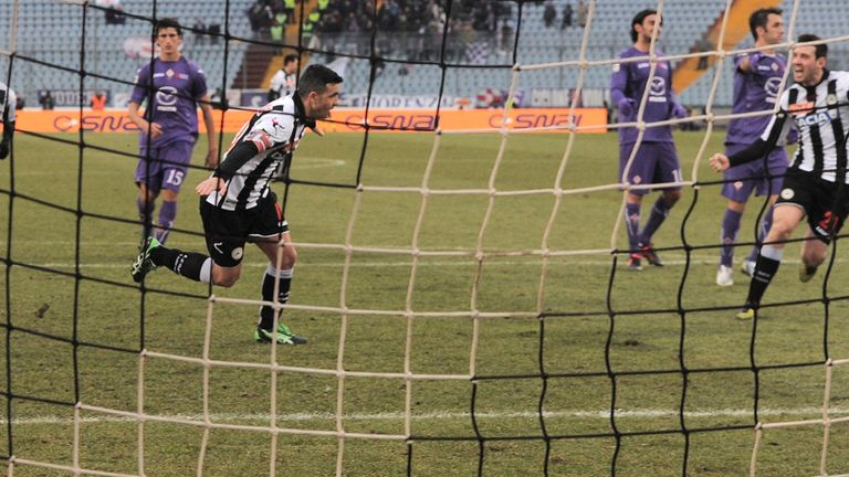 Antonio Di Natale celebrates after scoring from the spot