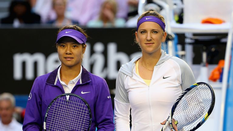 Li Na and Victoria Azarenka line up before the women's singles final