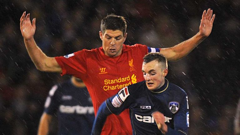 Steven Gerrard: Liverpool midfielder tussles with Oldham's Carl Winchester