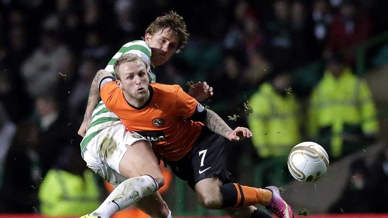 Thomas Rogne tussles with Johnny Russell during Celtic's win over Dundee United