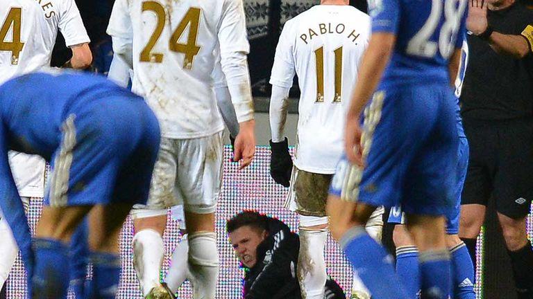 Ballboy: Lies in pain after clash with Eden Hazard