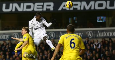 Emmanuel Adebayor heads Tottenham into the lead against Reading