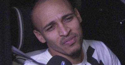 Peter Odemwingie: West Brom striker is pictured in his car at Loftus Road