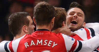 Celebration: Giroud is congratulated by his team-mates after grabbing his second for Arsenal