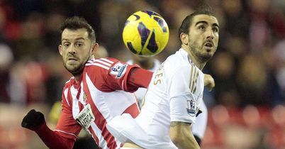 Steven Fletcher and Chico Flores battle for possession at the Stadium of Light