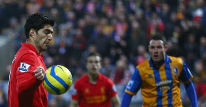Luis Suarez: Scored controversial goal to fire Liverpool to win