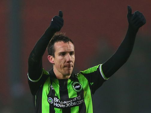 David Lopez celebrates his goal for Brighton