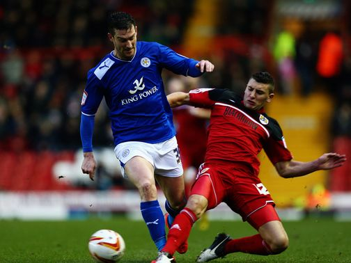 David Nugent is tackled by James Wilson
