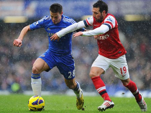 Cesar Azpilicueta holds off Santi Cazorla
