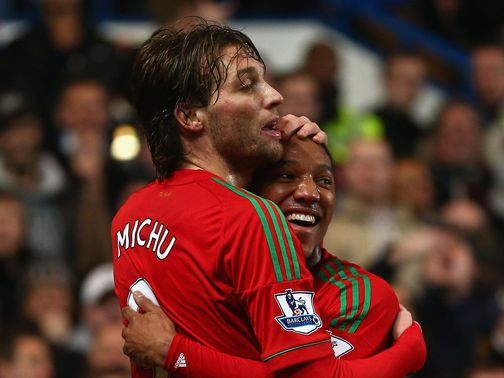 Michu celebrates at Stamford Bridge