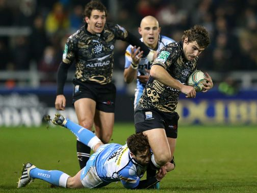 Johnnie Beattie is tackled by Sale's Danny Cipriani