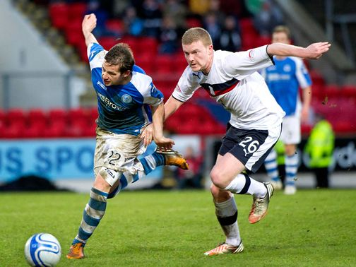 Peter Pawlett tries to get away from Brian Easton