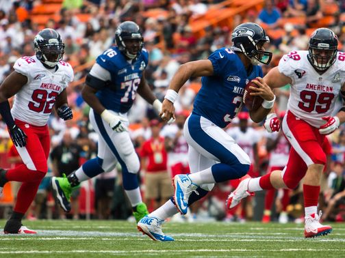 Quarterback Russell Wilson scrambles for the NFC